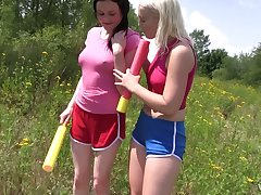 Two stunning girls are eating each others pussies in get under one's field in spacious daylight