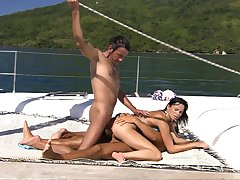 Renata Black gets her pussy filled with two hard penises in along to sky along to boat