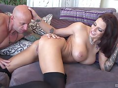 Busty bombshell Lilith Lavey rides cock in the matter of her paws cadence
